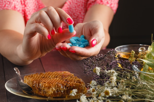 Healthcare and medicine: young woman has control over pills