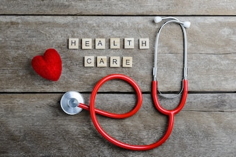 Healthcare text word made with wood blocks and Red Heart,stethoscope on wooden table