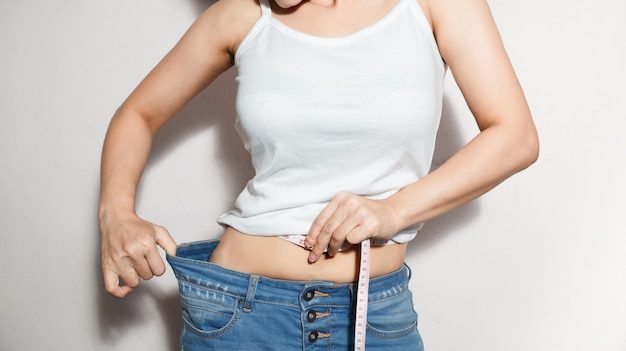 Healthcare and woman diet lifestyle concept to reduce belly and shape up healthy stomach muscle.