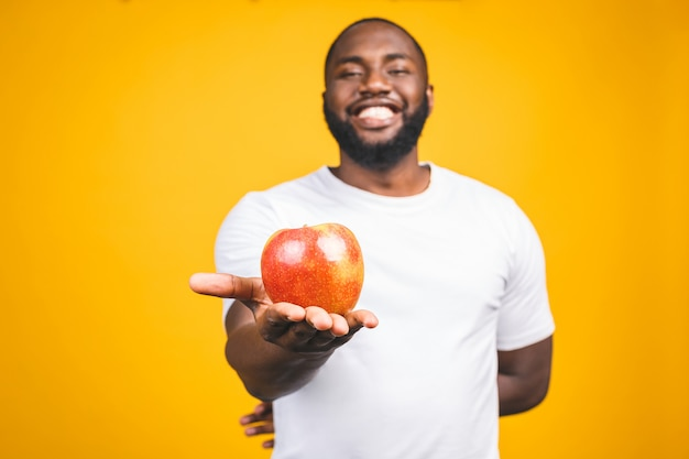 Healthy african american man holding an apple