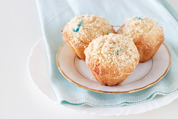Healthy apple oats streusel muffins on white plate.