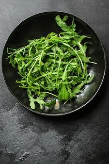 Healthy arugula salad food background