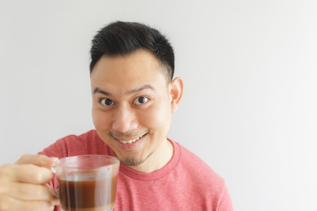 Healthy asian man offer herbal drink in a glass cup.