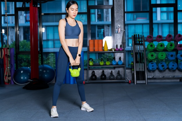 Healthy asian women are doing lifting gear,