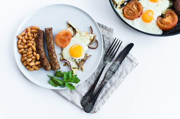 Healthy balanced breakfast on a grey plate on a white background.