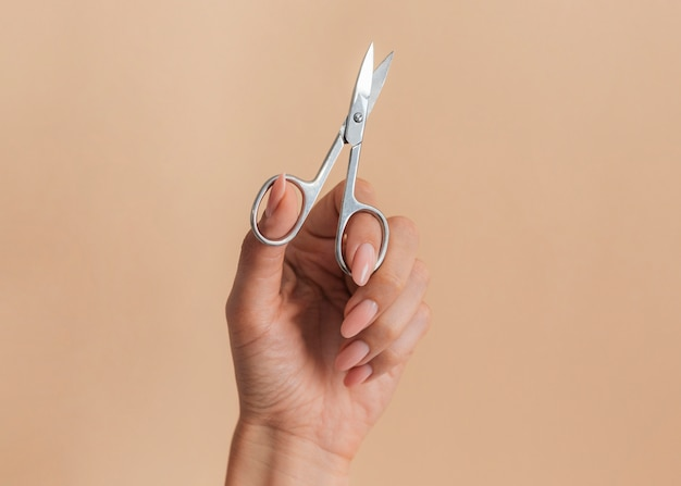 Healthy beautiful manicure and scissors