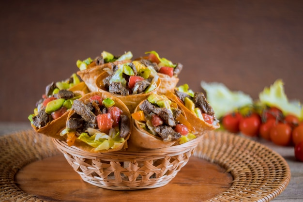 Healthy beef salad in tortilla cones in basked