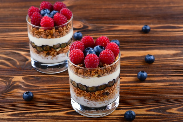 Healthy blueberry and raspberry parfait in a glass