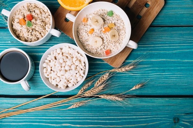 Healthy bowl of oatmeal and cereals on wooden table