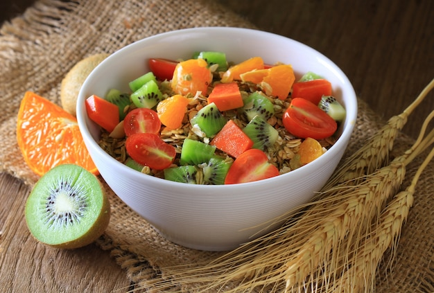 Healthy breakfast in a bowl on wooden floor