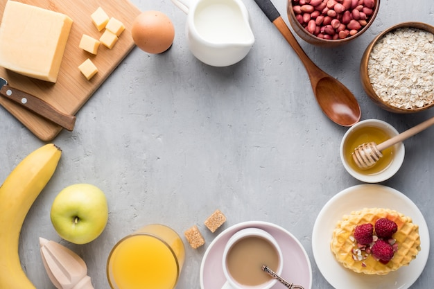 Healthy breakfast cheese juice coffee honey peanuts egg biscuits waffles cereal oatmeal apple banana