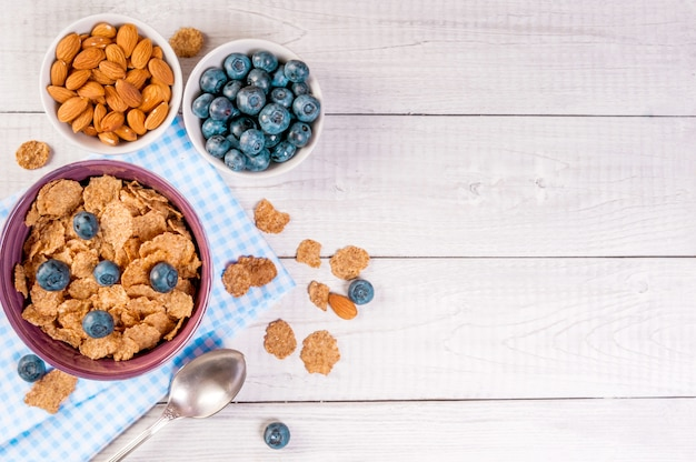 Healthy breakfast, cornflakes berries and milk, with text space top view close-up