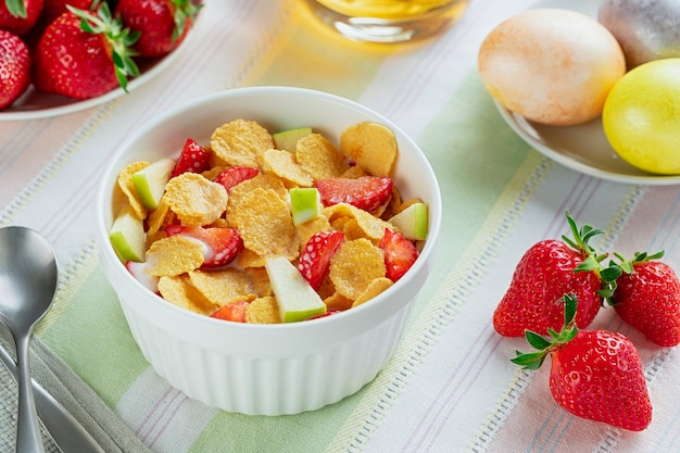 Healthy breakfast cornflakes and strawberries with milk and boiled eggs. bio healthy. close up