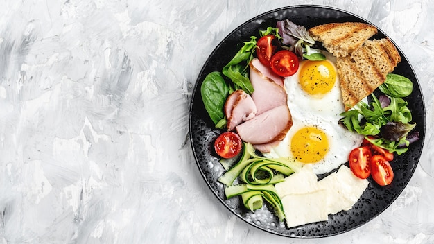 Healthy breakfast. english breakfast plate of fried eggs, ham and toast.banner, menu recipe place for text, top view.
