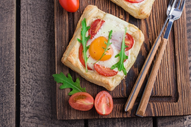 Healthy breakfast- fried egg with red pepper and tomato cherry on wooden board