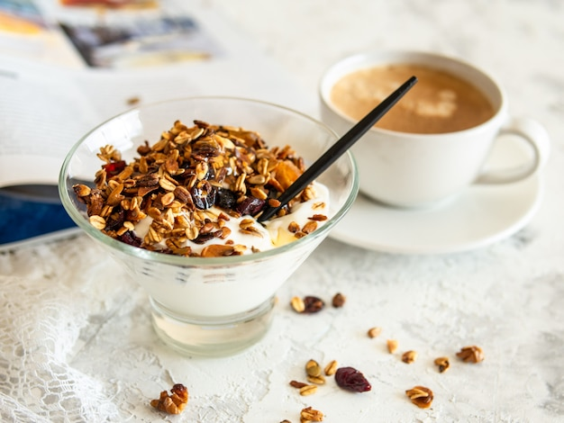 Healthy breakfast. granola, muesli with pumpkin seeds, honey, yogurt in a glass bowl