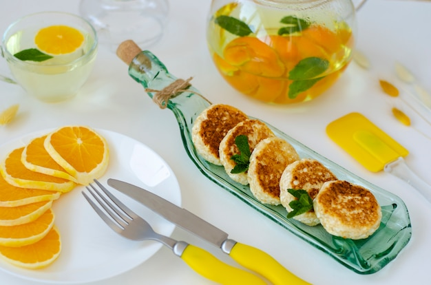 Healthy breakfast made of pancakes from cottage cheese on transparent serving plate