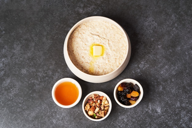 Healthy breakfast - milk rice porridge in a white plate on grey table background