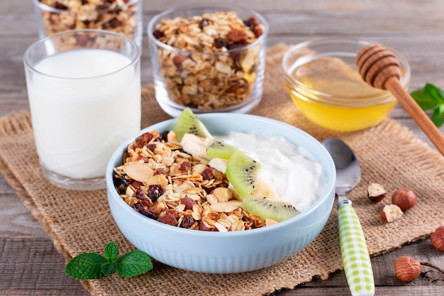 Healthy breakfast. muesli and yogurt with kiwi and banana. healthy breakfast dieting concept