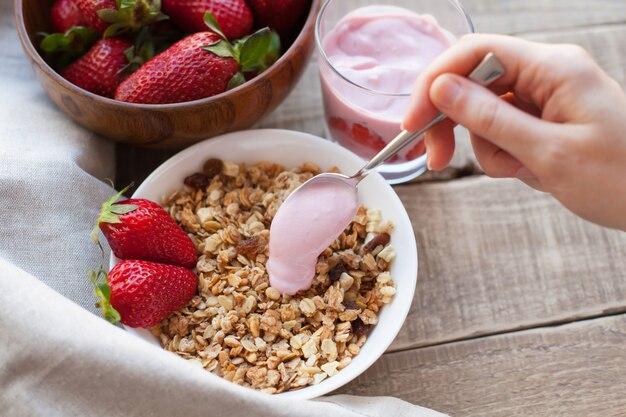 Healthy breakfast. muesli and yogurt with strawberries
