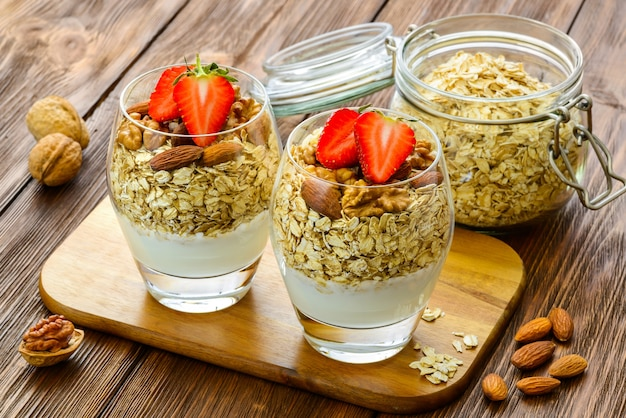 Healthy breakfast. natural yogurt with muesli and walnut.