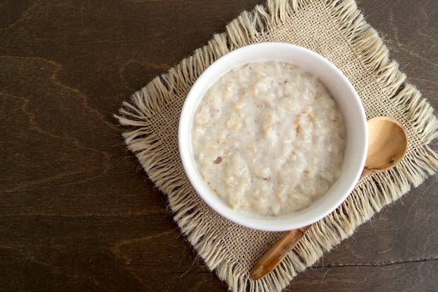 Healthy breakfast. oatmeal in a white bowl