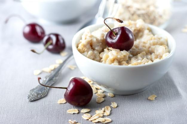 Healthy breakfast oatmeal with cherries