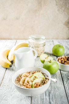 Healthy breakfast oatmeal with nuts ad fruits