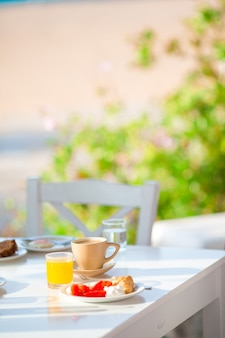 Healthy breakfast in outdoor cafe