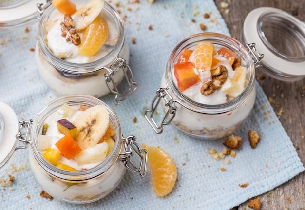 Healthy breakfast overnight oats with fresh fruit in a glass jar