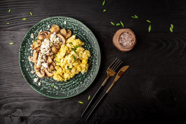Healthy breakfast scrambled eggs with mushrooms and cottage cheese