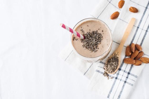 Healthy breakfast smoothie oatmeal almond milk chia on white background