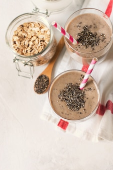 Healthy breakfast smoothie with chia seeds on white background