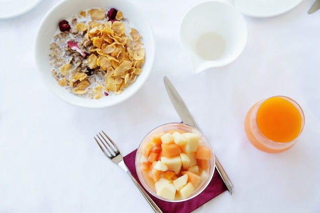 Healthy breakfast on the white table in the restaurant. top view