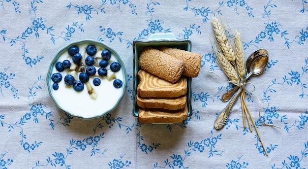 Healthy breakfast with blueberries and banana yogurt