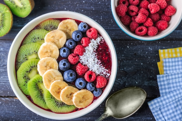 Healthy breakfast with delicious acai smoothie in bowl