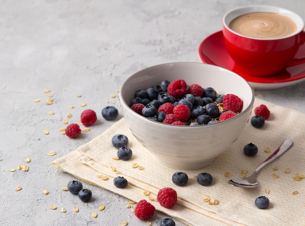 Healthy breakfast with oatmeal, coffee and berries.