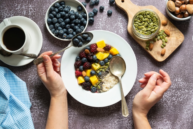 Healthy breakfast with oatmeal porridge with fruits