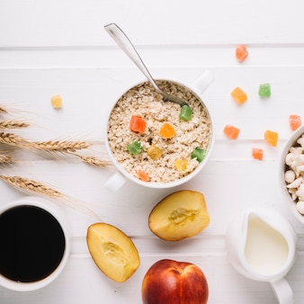 Healthy breakfast with oatmeal on white table