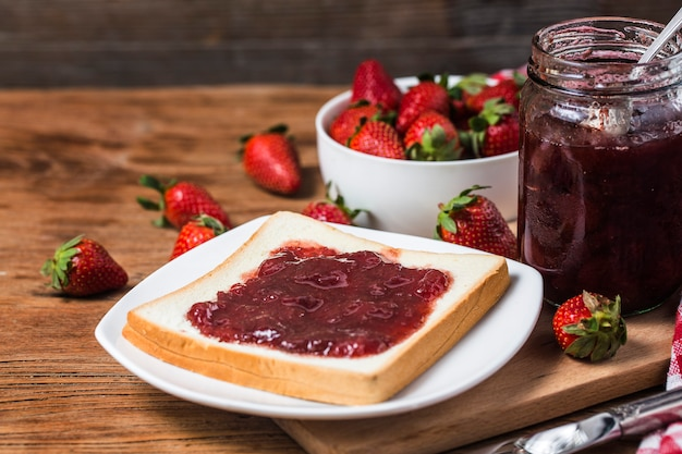 Healthy breakfast with strawberry jam