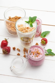 Healthy breakfast with yoghurt, granola and strawberries