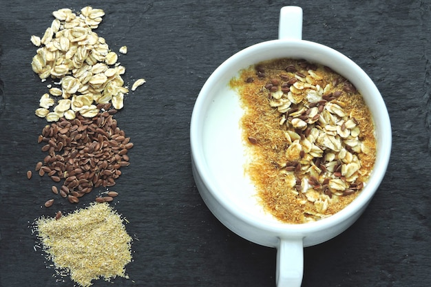 Healthy breakfast with yogurt, bran and seeds. healthy food. diet food.
