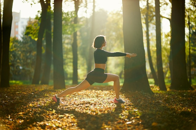 Healthy brunette stretching body before fitness exercises