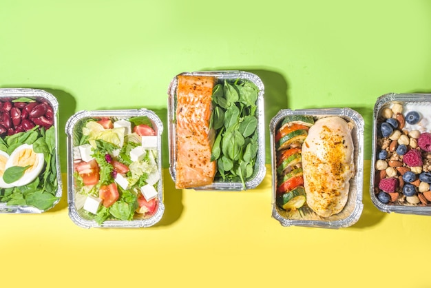 Healthy catering menu, courier food delivery lunch boxes. beef steak meat, chicken filet , fish and vegetables in packages. daily meal diet plan delivery , take away containers, online order concept