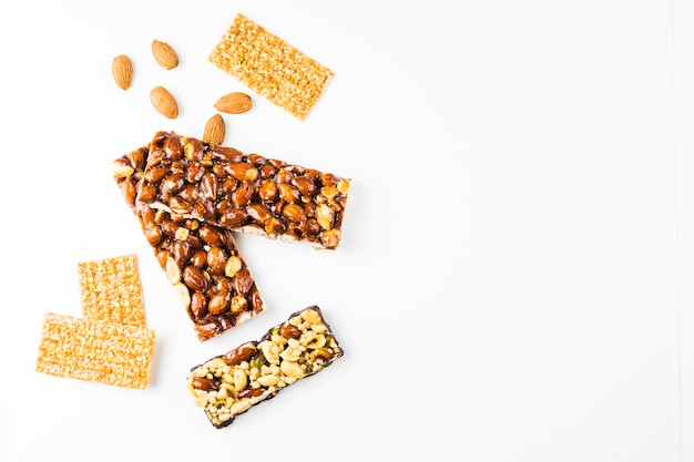 Healthy cereal and almonds proteins bars against white background