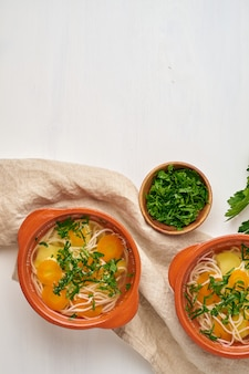 Healthy chicken soup with vegetables and rice noodles