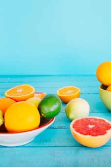 Healthy citrus fruits on blue wooden table top
