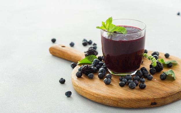 Healthy clean eating, blackberry and blueberry summer smoothie