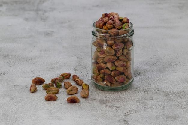 Healthy crunchy pistachio nuts in a jar