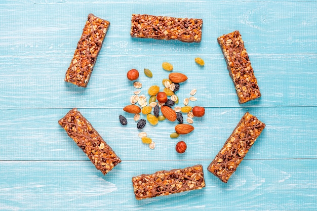 Healthy delicios granola bars with chocolate, muesli bars with nuts and dry fruits, top view